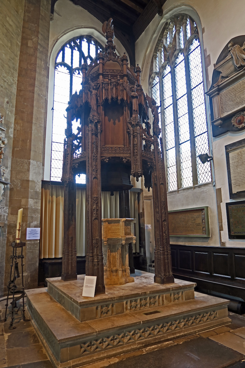 Font with wooden canopy (15th c.)
